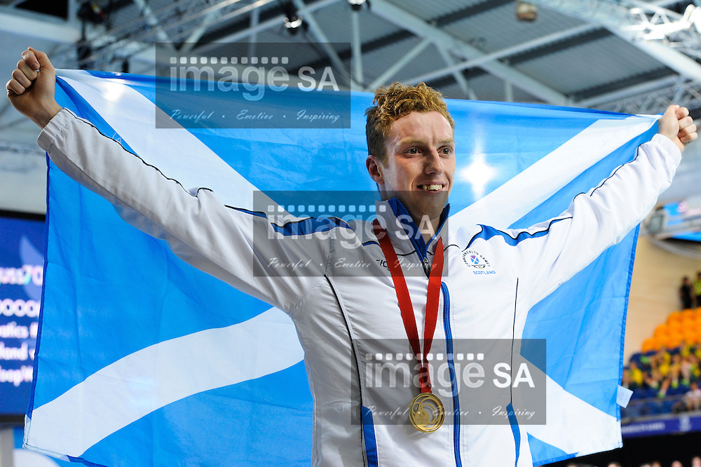GLASGOW, SCOTLAND - JULY 25: Daniel Wallace of Scotland poses with his gold medal in the mens 400m Individual Medley during the swimming on day 2 of the 20th Commonwealth Games at Tollcross Swimming Centre on July 25, 2014 in Glasgow, Scotland. (Photo by Roger Sedres/ImageSA)