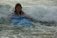 A 9 year-old girl boogie boarding in San Diego.
