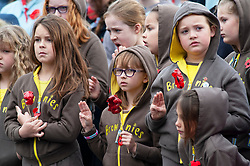 © Licensed to London News Pictures. 11/11/2018. Orpington, UK.Brownies hold poppies at the service. Ex-transport minister and MP for Orpington Jo Johnson attending the Remembrance day service at Orpington war memorial to mark one hundred years since the end of the first world war.Photo credit: Grant Falvey/LNP