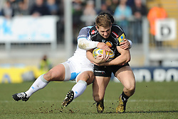 Sam Hill of Exeter Chiefs is tackled by Juan Pablo Socino of Newcastle Falcons.  - Mandatory byline: Alex Davidson/JMP - 12/03/2016 - RUGBY - Sandy Park -Exeter Chiefs,England - Exeter Chiefs v Newcastle Falcons - Aviva Premiership
