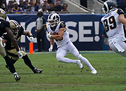 Los Angeles Rams wide receiver Cooper Kupp (18) runs with the ball during an NFL football game against the New Orleans Saints, Sunday, Sept. 15, 2019, in Los Angeles. The Rams defeated the Saints 27-9. (Dylan Stewart/Image of Sport)