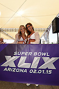 Feb 1, 2015; Glendale, AZ, USA; Arizona Cardinals cheerleaders Megan (left) and Catie (right) pose for a photo before Super Bowl XLIX between the New England Patriots and the Seattle Seahawks at University of Phoenix Stadium. The Patriots defeated the Seahawks 28-24.