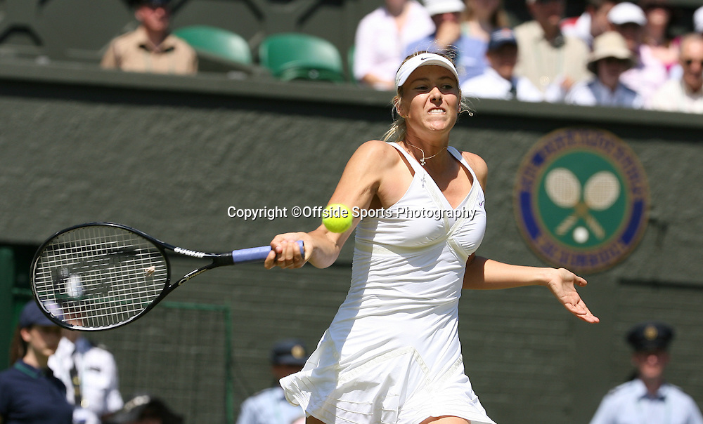 24/06/2009. The All England Lawn Tennis Championships. Maria Sharapova plays a shot during her 2nd round match with Gisela Dulko. Wimbledon, UK. Photo: Offside/Steve Bardens.