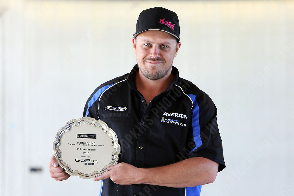 Karl Wilson poses with the winners' plate during the 2013 Superkart National Champs and Grand Prix at Manfeild in Feilding, New Zealand on Saturday, 5 January 2013. Credit: Hagen Hopkins.