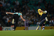 Stuart Meaker of Surrey attempts to run out Grant Elliott during the NatWest T20 Blast South Group match between Surrey County Cricket Club and Warwickshire County Cricket Club at the Kia Oval, Kennington, United Kingdom on 25 August 2017. Photo by Dave Vokes.