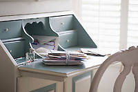 Letters tied with ribbon on writing desk