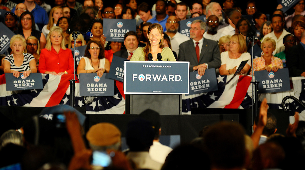 LAURA FONG   SUMMER KENT STATER Obama supporter Jen Ackerman, from Cuyahoga Falls, Ohio, introduces President Barack Obama at the John S Knight Center in Akron Wednesday.