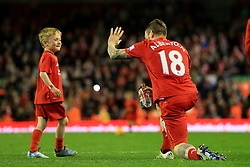 Alberto Moreno of Liverpool gives a high five to his son after the match - Mandatory byline: Matt McNulty/JMP - 11/05/2016 - FOOTBALL - Anfield - Liverpool, England - Liverpool v Chelsea - Barclays Premier League