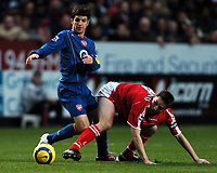 Photo: Javier Garcia/Back Page Images<br />Charlton Athletic v Arsenal, FA Barclays Premiership, The Valley 01/01/2005<br />Cesc Fabregas wins the midfield battle against Matt Holland