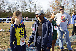Whitfield Academy Cross Country coach Judy Deany, right, gives last miniute instructions to Rachel Cowles before the 2010 KHSAA State Cross Country Championships held at the Kentucky Horse Park in Lexington Nov. 13, 2010. (By Jonathan Palmer, Special to the Courier-Journal) Nov. 13, 2010
