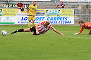 Danny Wright gets the ball round Fabian Spiess to score during the Vanarama National League match between Torquay United and Cheltenham Town at Plainmoor, Torquay, England on 29 August 2015. Photo by Antony Thompson.
