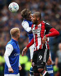 Leon Clarke of Sheffield United wins a header above Adam Reach of Sheffield Wednesday - Mandatory by-line:  Matt McNulty/JMP - 24/09/2017 - FOOTBALL - Hillsborough - Sheffield, England - Sheffield Wednesday v Sheffield United - Sky Bet Championship