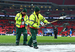 Ground staff try to remove snow from the side of the pitch at Wembley Stadium ahead of the FA Cup Fifth Round replay between Tottenham Hotspur and Rochdale - Mandatory by-line: Robbie Stephenson/JMP - 28/02/2018 - FOOTBALL - Wembley Stadium - London, England - Tottenham Hotspur v Rochdale - Emirates FA Cup fifth round proper