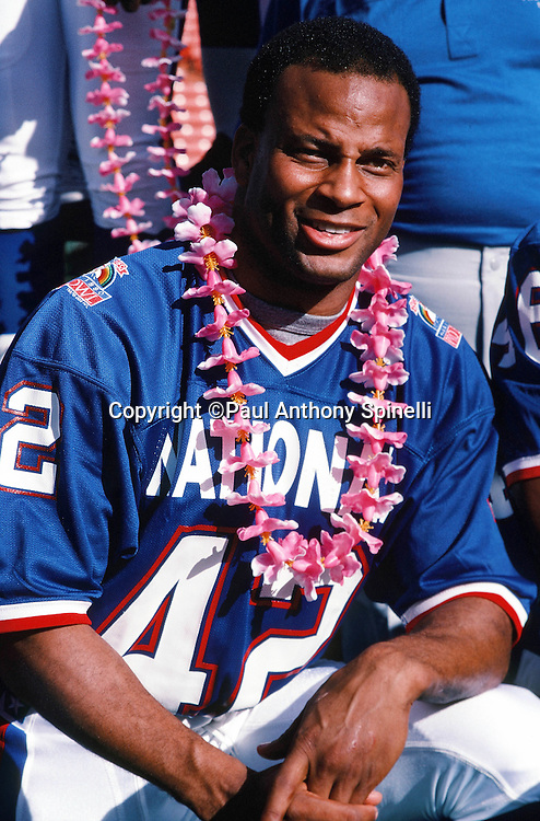 San Francisco 49ers safety Ronnie Lott (42) poses for a photo with a lei on photo day during the week of the 1990 NFL Pro Bowl between the National Football Conference and the American Football Conference on Jan. 30, 1990 in Honolulu. The NFC won the game 27-21. (©Paul Anthony Spinelli)