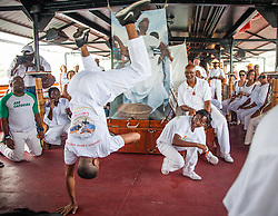Members of Libertad Capoeira and Grupo Axe Capoeira provide a Capoeira demonstration during the tour.  9th Annual Dollar Fo' Dollar Culture and History Tour, a remembrance of the 1892 Coal Workers Strike on St. Thomas.  20 September 2014.  St. Thomas, USVI.  © Aisha-Zakiya Boyd
