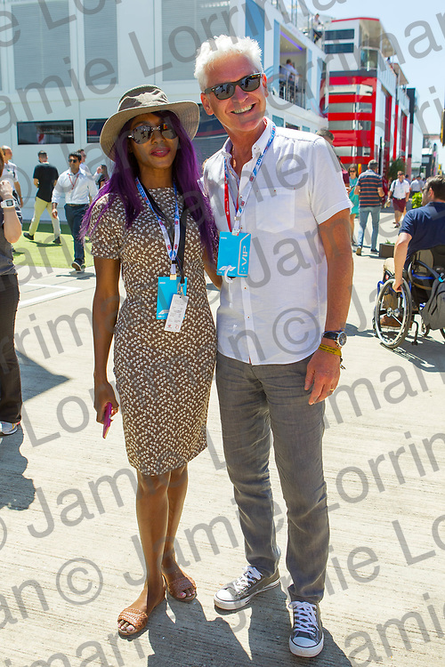 The 2018 Formula 1 F1 Rolex British grand prix, Silverstone, England. Sunday 8th July 2018.<br /> <br /> Pictured: TV presenter Phillip Schofield and singer Sinitta pose in the paddock ahead of the race at Silverstone.<br /> <br /> Jamie Lorriman<br /> mail@jamielorriman.co.uk<br /> www.jamielorriman.co.uk<br /> 07718 900288