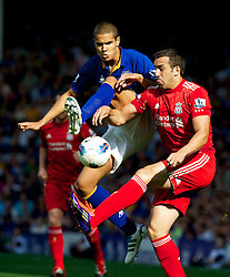 LIVERPOOL, ENGLAND - Saturday, October 1, 2011: Liverpool's Jose Enrique in action against Everton's Jack Rodwell during the Premiership match at Goodison Park. (Pic by David Rawcliffe/Propaganda)