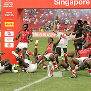Kenyans collapse in joy after receiving the championship Cup at the HSBC Singapore 7's, day 2, Singapore National Stadium, Singapore.  Photo by Barry Markowitz, 4/17/16