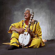 ElDabh Studio Portrait With Instrument:<br /> This photo of Emeritus University Professor Halim ElDabh appears on the cover of his recent biography by Dr. Denice Seacrist. It  provides an account of his contribution to world music including compositions that are heard at the pyramids in Egypt.