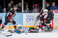 KELOWNA, CANADA -FEBRUARY 25: Rourke Chartier #14 of the Kelowna Rockets is checked to the ice by Tate Olson #25 of the Prince George Cougars on February 25, 2014 at Prospera Place in Kelowna, British Columbia, Canada.   (Photo by Marissa Baecker/Getty Images)  *** Local Caption *** Rourke Chartier; Tate Olson;