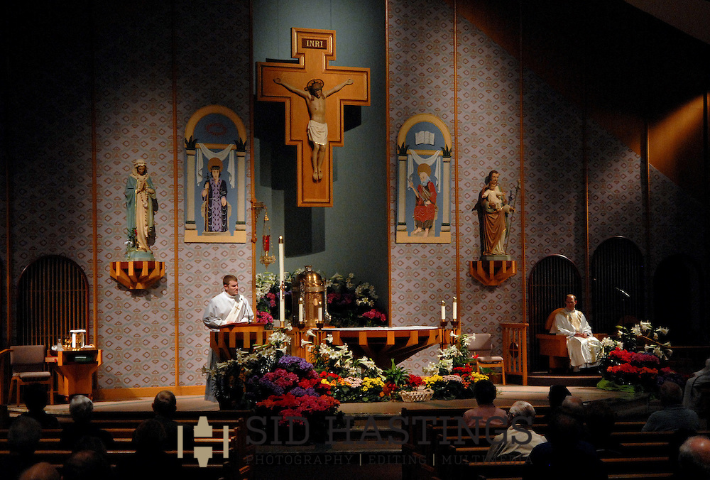 1 MAY 2011 -- ST. LOUIS -- The Rev. Mr. Timothy Foy, transitional deacon at St. Margaret Mary Alacoque Catholic Church, deliver the Homily during the 7 am Mass at the church in St. Louis Sunday, May 1, 2011. This was his last Sunday in service at the church as a deacon. Image © copyright 2011 Sid Hastings.