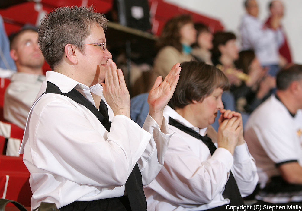 Robins Late Bloomer's Sandii Duffy (left), age 58, and Pat Oliver (right), age 56, applaud as the watch the second half of the women's Coe vs Simpson basketball game at Coe College on February 14, 2007.
