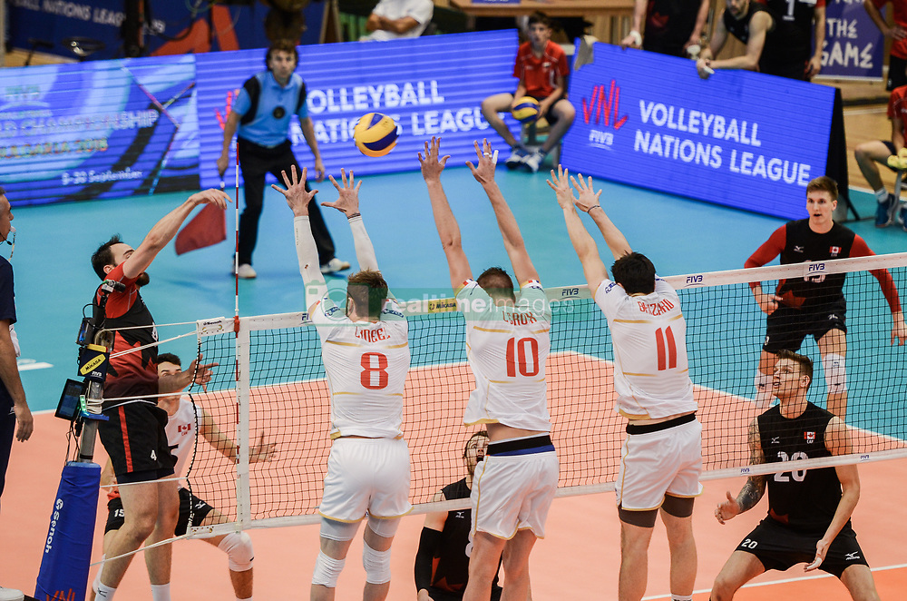 June 17, 2018 - Varna, Bulgaria - Nicholas Hoag, Canada play the ball against Frnace, during Mens Volleyball Nations League, VNL, match between France and Canada at Palace of Culture and Sport in Varna, Bulgaria on June 17, 2018  (Credit Image: © Hristo Rusev/NurPhoto via ZUMA Press)