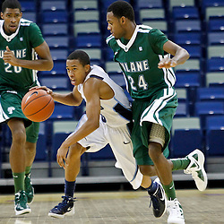 November 27, 2011; New Orleans, LA; San Diego Toreros guard Christopher Anderson (0) drives past Tulane Green Wave guard Jay Hook (24) during the second half of the Hoops for Hope Classic at the New Orleans Arena. Tulane defeated San Diego 65-46. Mandatory Credit: Derick E. Hingle-US PRESSWIRE