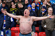Picture by David Horn/Focus Images Ltd +44 7545 970036<br /> 14/12/2013<br /> A Sheffiled Wednesday fan braves the cold before the Sky Bet Championship match at Vicarage Road, Watford.