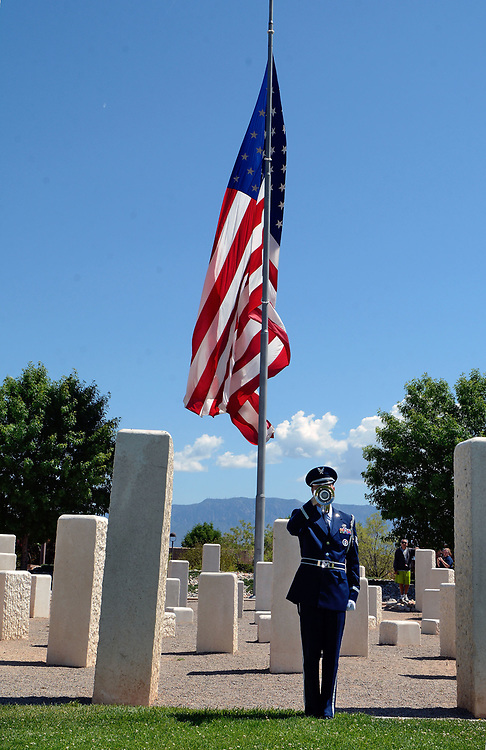 jt052917a/ a sec/jim thompson/  Staff Sgt. Daniel Percival with the KAFB Honor Guard plays taps at the closing of the Memorial Day Ceremony held at the New Mexico Veteran's Memorial. Monday May. 29, 2017. (Jim Thompson/Albuquerque Journal)