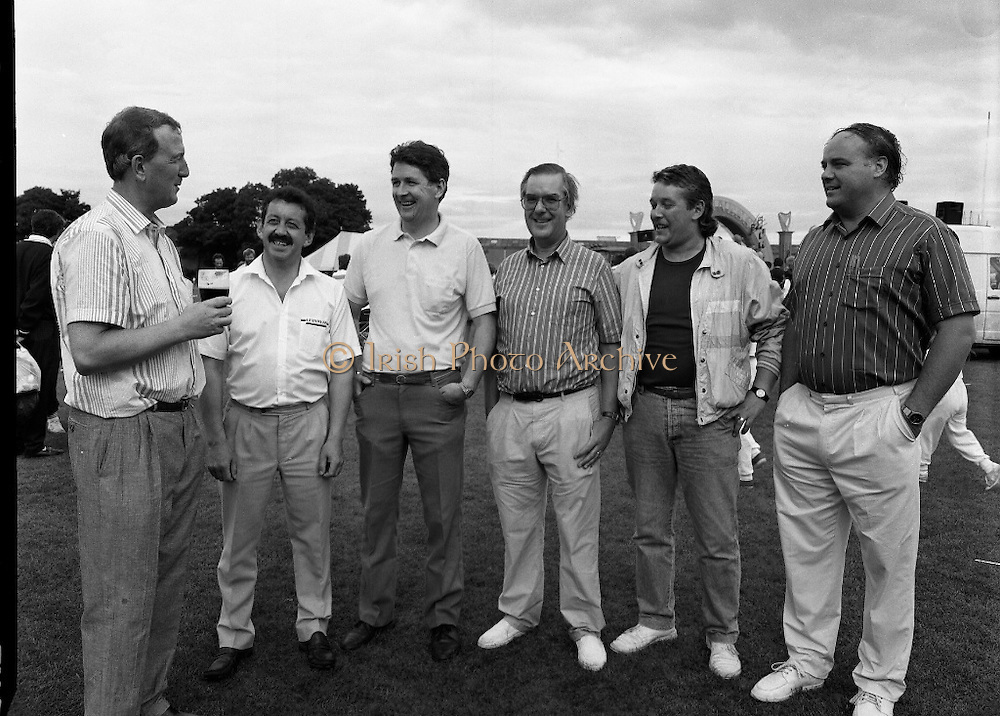 "Guinness Family Day At The Iveagh Gardens. (R83)..1988..02.07.1988..07.02.1988..2nd  July 1988..The family fun day for Guinness employees and their families took place at the Iveagh Gardens today. Top at the bill at the event were ""The Dubliners"" who treated the crowd to a performance of all their hits. Ireland's penalty hero from Euro 88, Packie Bonner, was on hand to sign autographs for the fans...Members of the organising committee are pictured having a break at the end of a very successful event."