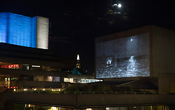 © Licensed to London News Pictures. 26/09/2018. London, UK. Artist Epoh Beech's hand drawn animated film The Masque of Blackness is projected onto The National Theatre flytower for Totally Thames 2018.  The projection is showing from Thursday 27 – Saturday 29 September from 8pm to 11pm and forms part of the annual celebration of the River Thames - a creative and diverse season of events that inspires, connects and enthrals throughout the month of September - curated and managed by the Thames Festival Trust. Photo credit: Peter Macdiarmid/LNP