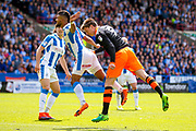 Sheffield Wednesday midfielder Adam Reach (9) heads goal wards during the EFL Sky Bet Championship play off first leg match between Huddersfield Town and Sheffield Wednesday at the John Smiths Stadium, Huddersfield, England on 14 May 2017. Photo by Simon Davies.