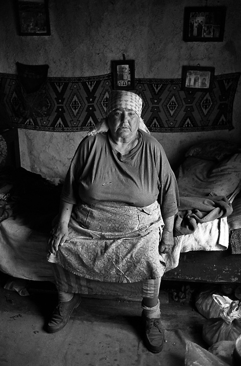 Title: Roma woman in her modest home, Posmus, Transylvania. August 1996.