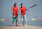 Women Kayakers Yang Yali (L) and Wang Feng in Yanqing, where she is training for the Beijing 2008 Olympics.