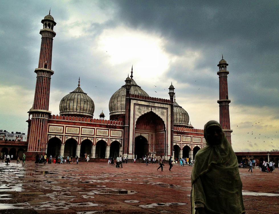 I visitor scurries to cover as it starts raining over the mosque in Old Delhi. The Jama Masjid of Old Delhi is the larges mosque in India.