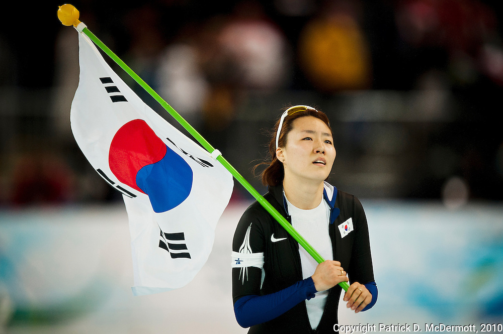 Sang-Hwa Lee, KOR, celebrates her victory in the Women's 500m speed skating competition during the 2010 Vancouver Winter Olympics at the Richmond Olympic Oval in Richmond, British Columbia, Tuesday, Feb. 16, 2010. Lee won the gold medal with total time of 76.09.