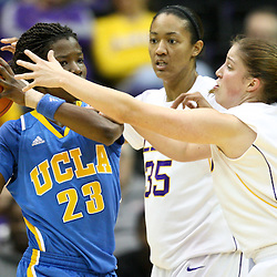 December 13, 2011; Baton Rouge, LA; UCLA Bruins forward Markel Walker (23) is defended by LSU Lady Tigers forward Taylor Turnbow (35) and guard Jeanne Kenney (5) during the first half of a game at the Pete Maravich Assembly Center.  Mandatory Credit: Derick E. Hingle-US PRESSWIRE
