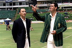 L-R; England's Captain Nasser Hussain watches as South Africa's Captain Hansie Cronje flicks the coin for the toss