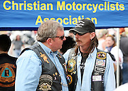 "Mark Lunsford  speaks with a member of the Christian Motorcyclist's Association at the end of the 3rd Jessie's Ride in Crystal River, Florida.  Lunsford's daughter, nine-year-old Jessica, was kidnapped and murdered by a registered sex offender.  She was reported missing exactly two years ago on Feb. 24, 2005.  Lunsford has spent the past two years raising awareness and working to pass ""Jessica's Act"" strengthening penalties against child predators.  To date, the act has passed in 26 states."