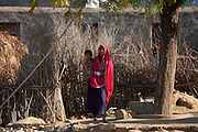Indian woman with grandchild at home in Narlai village in Rajasthan, Northern India