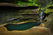 Robinson Falls, also known as Corkscrew Falls, carves through a small gorge of Black Hand Sandstone. Boch Hollow State Nature Preserve. Hocking Hills Ohio