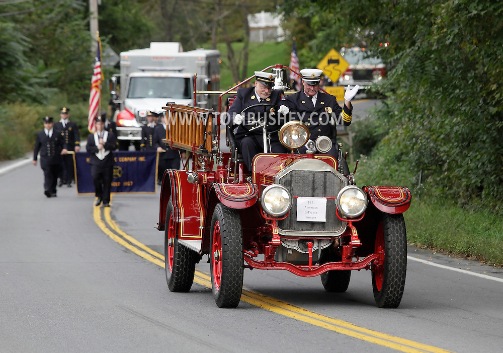 Salisbury Mills, New York - A 1921 American LaFrance pumper drives down Route 94 during the Orange County Volunteer Firemen's Association (OCVFA) annual parade on Sept. 24, 2011.