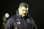 AFC Wimbledon first team coach Simon Bassey  walking off the pitch during the EFL Sky Bet League 1 match between AFC Wimbledon and Walsall at the Cherry Red Records Stadium, Kingston, England on 25 November 2017. Photo by Matthew Redman.