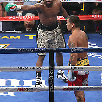 LAS VEGAS, NV - SEPTEMBER 13: (L-R) Floyd Mayweather Jr. instructs Marcos Maidana back to his corner during their WBC/WBA welterweight title fight at the MGM Grand Garden Arena on September 13, 2014 in Las Vegas, Nevada. (Photo by Alex Menendez/Getty Images) *** Local Caption *** Floyd Mayweather Jr; Marcos Maidana
