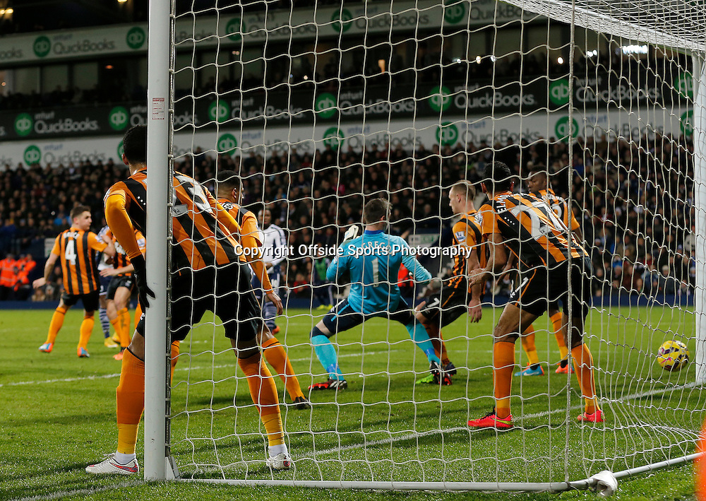 10th January 2015 - Barclays Premier League - West Bromwich Albion v Hull City - Saido Berahino of West Bromwich Albion scores through a crowded area (1-0) from a free kick inside the box - Photo: Paul Roberts / Offside.