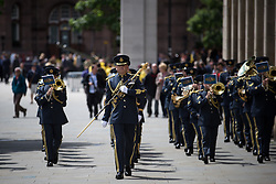 © Licensed to London News Pictures . 01/07/2016 . Manchester , UK . Forming up at St Peter's Square by the Cenotaph . Somme100 events in Manchester City Centre to commemorate the 100th anniversary of the first day of the Battle of the Somme . Photo credit : Joel Goodman/LNP