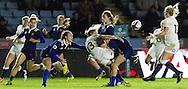Claire Allan passes the ball to Rachael Burford whilst being tackled, England Women v France Women in an Old Mutual Wealth Series, Autumn International match at Twickenham Stoop, Twickenham, England, on 9th November 2016. Full Time score 10-5