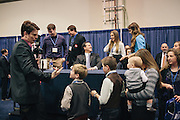 Rick Santorum is greeted by the Duggar family toward the end of his book signing during day two of the Conservative Political Action Conference (CPAC) at the Gaylord National Resort & Convention Center in National Harbor, Md. The Duggar family is known for the reality show 19 and Counting.
