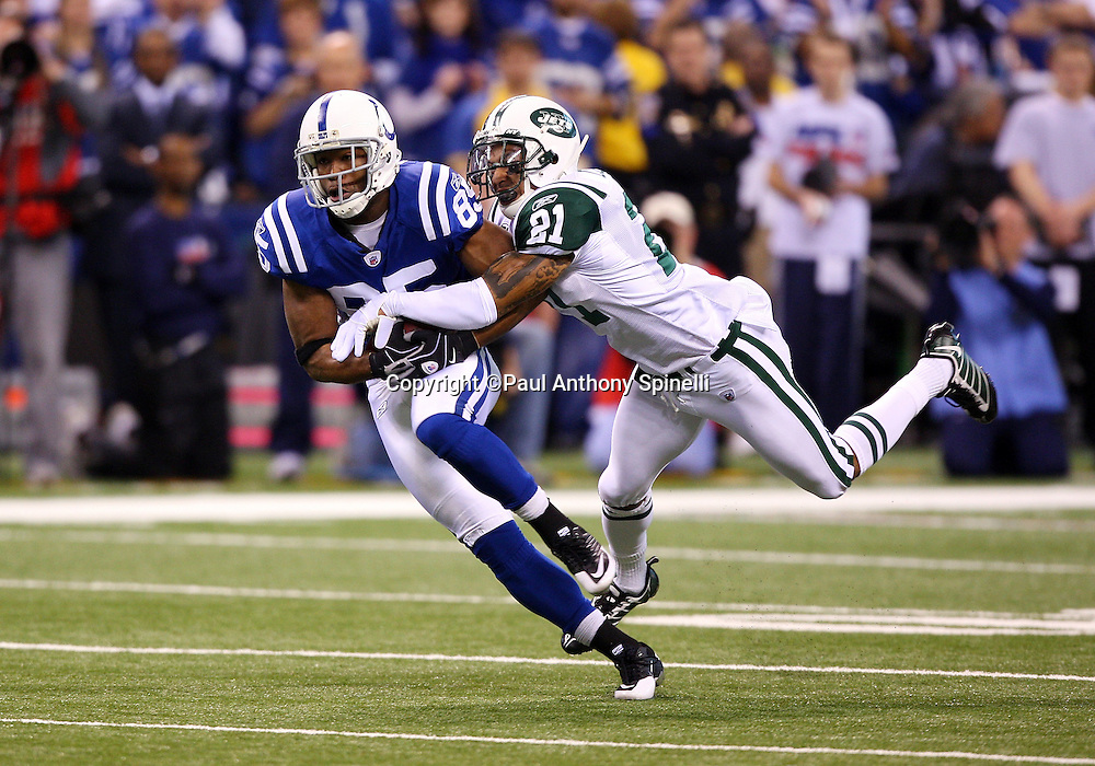 Indianapolis Colts wide receiver Pierre Garcon (85) catches a first quarter pass good for a first down while covered by diving New York Jets cornerback Dwight Lowery (21) during the AFC Championship football game against the New York Jets, January 24, 2010 in Indianapolis, Indiana. The Colts won the game 30-17. ©Paul Anthony Spinelli